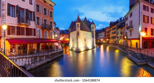 Panorama wit the Palais de l'Isle and Thiou river during morning blue hour in old city of Annecy, Venice of the Alps, France