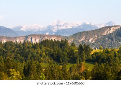 Panorama of the wooden hut and tops of the mountains of Triglav National Park. Slovenia, Triglav region. Slovenian Alps. Julian Alps in summer.