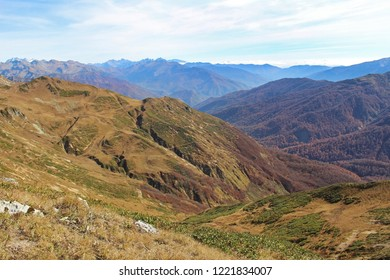 Panorama with yellow autumn hills and mountains. The photo was taken in the valley of the seven lakes, the Republic of Abkhazia.