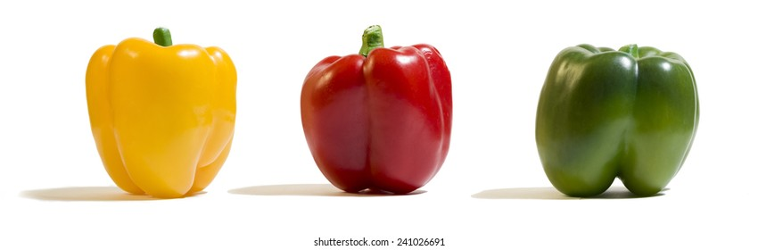 Panorama of a yellow, red and green peppers. White background.