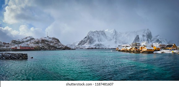 Panorama of yellow rorbu houses of Sakrisoy fishing village with snow in winter. Lofoten islands, Norway