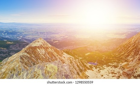 Panorama of  Zolta Turnia Peak and Red Pond at sunset from Skrajny Granat Peak, high Tatra mountains, Poland