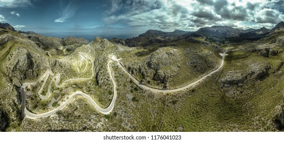 Panorama-/Aerial-view of the Tramuntana mountains of Mallorca with a country road / serpentine