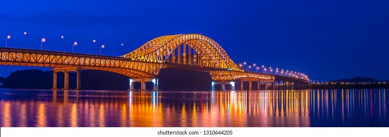 Panorama,Night view Banghwa bridge, railway bridge over Han River in Seoul, South Korea.