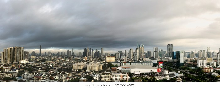 Panoramas of the skyscraper in downtown Bangkok cityscapes, the capital of Thailand in southeast Asia, with rain cloud at morning.