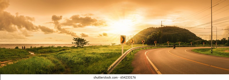 panorama,Scenic view of the asphalt road along the seashore in the evening, Chanthaburi, Thailand