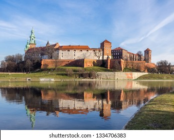 The panoramatic day view of Wawel Castle with reflection in Visla river in the foreground . Krakow, Poland.