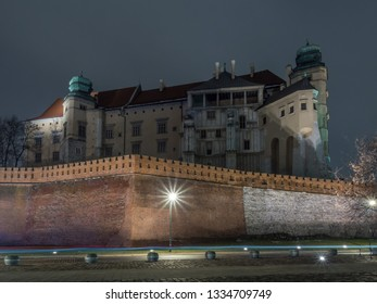 The panoramatic night side view of Wawel Castle with street lamps. Krakow, Poland.