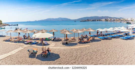 Panoramatic view of Haraki beach and holiday-makers (Rhodes, Greece)