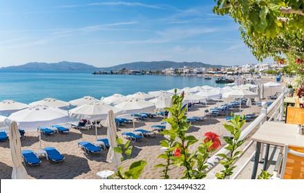Panoramatic view of sun beds and sunshades on Haraki beach (Rhodes, Greece)