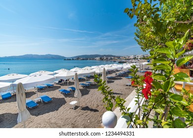 Panoramatic view of sun beds and sunshades on Haraki beach (Rhodes, Greece)
