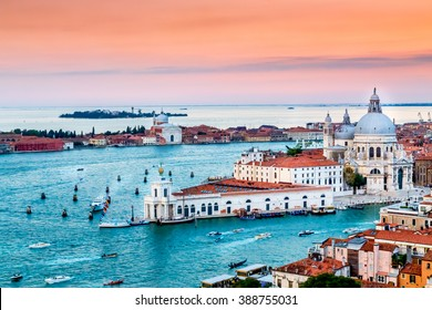 Panoramic aerial cityscape of Venice and Grand Canal with Santa Maria della Salute church at sunset, view from Campanile di San Marco to Venetian Lagoon, Italy
