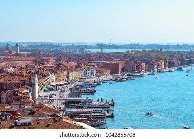 Panoramic aerial cityscape view to Venice in Italy, buildings and sea, view from top