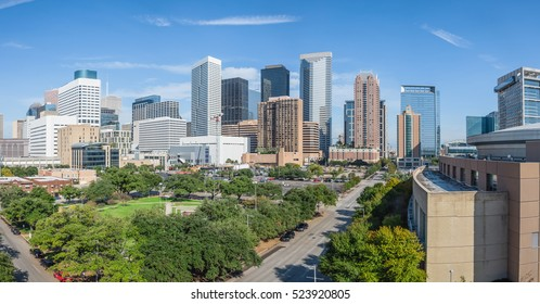 Panoramic aerial day view of Houston downtown skylines with green park trees and skyscrapers background in blue cloud sky. Houston is the most populous city in Texas and the fourth populous city in US