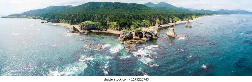 Panoramic aerial drone photo of cape Ptichiy, near by Velikan, Sakhalin island, Russia (Sahalin). Surrealistic landscape, natural arches created by wind and sea erosion. Pacific Ocean, Sea of Okhotsk.