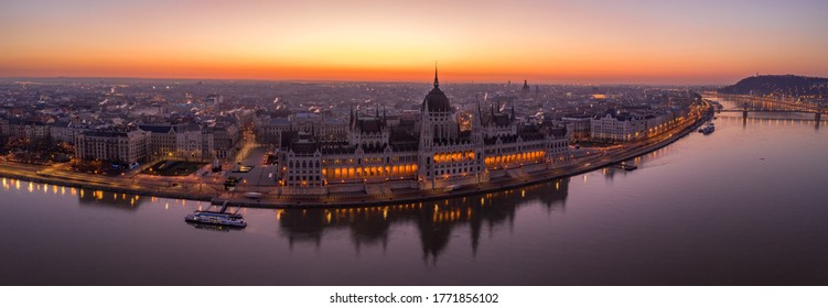 Panoramic aerial drone shot of Hungarian Parliament lights off before sunrise in Budapest dawn
