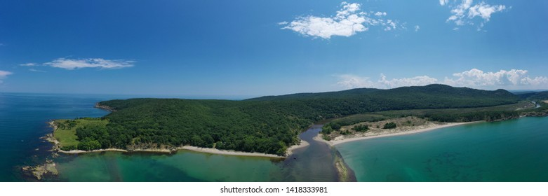Panoramic aerial drone view of river flowing into the sea. Ropotamo river, Bulgaria