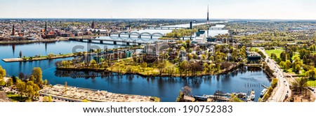 Panoramic aerial image horizontal photo of Riga cityscape centre capital of Latvia, Daugava river sunny spring day, banner for website header design, copy space. European city, horizon over land