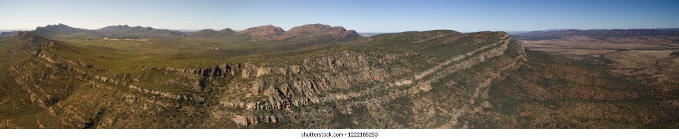 Panoramic Aerial landscape view in the late afternoon of the Southern Escarpment of Wilpena Pound in the Flinders Ranges, South Australia.