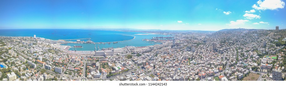 Panoramic aerial photo of the city of Haifa and the port of Haifa from up the side of Mount Carmel