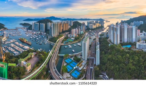 Panoramic Aerial view of the Aberdeen Harbour (Aberdeen Typhoon Shelter) and Ap Lei Chau Bridge in Hong Kong