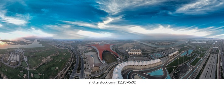 Panoramic aerial view of Abu Dhabi Yas Island sunset skyline.