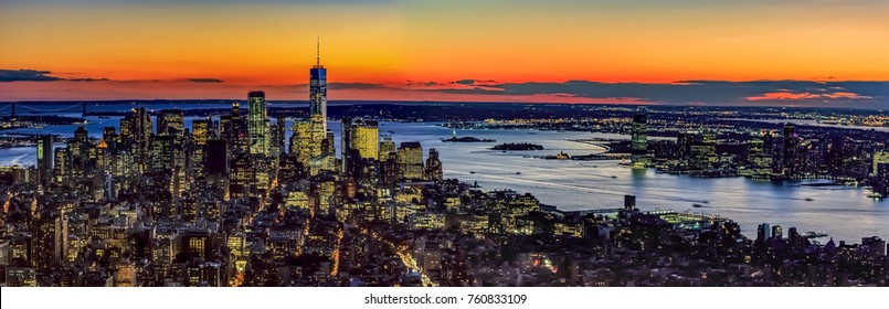 Panoramic aerial view across lower Manhattan and New Jersey, after sunset.