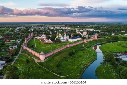 Panoramic aerial view of ancient city Suzdal and Saviour Monastery of St. Euthymius at sunset. Golden ring of Russia, Vladimir region. Aerial drone photo.