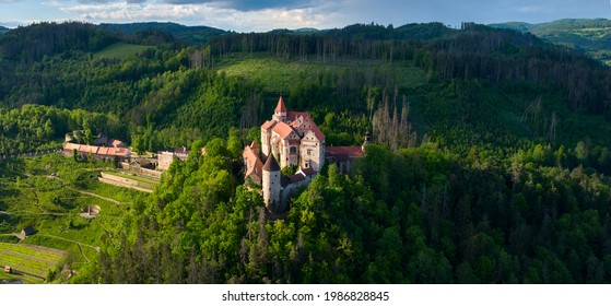 Panoramic, aerial view of ancient royal Moravian castle Pernstejn with new Vrchnostenska garden, illuminated by sun against dark forest. Aerial photography. Bohemian-Moravian Highlands, Czech castles - Shutterstock ID 1986828845