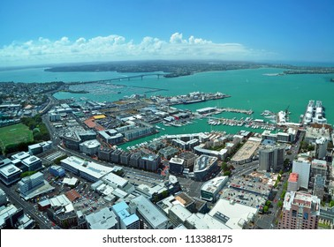 Panoramic aerial view of Auckland City &  Waitemata Harbour looking northwest to  the Auckland Harbour Bridge. In the foreground over 135,000 yachts and power boats are moored in several marinas.