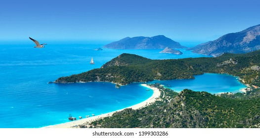 Panoramic aerial view of blue lagoon and sand beach in Oludeniz, Fethiye, Turquoise Coast of southwestern Turkey. Sunny bright and clear blue sky in Oludeniz.
