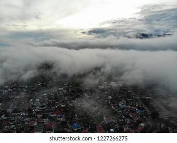 Panoramic aerial view of Bukit Tinggi, Padang, West Sumatera during hazy morning with clouds. Background with Singgalang Mount, Merapi Mount, Bukit Tinggi town and Jam Gadang under construction.