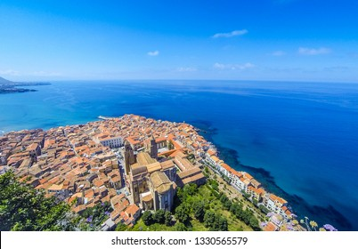 Panoramic aerial view of Cefalu old town, Sicily, Italy. Cefalu is one of the major tourist attractions in the region. Picturesque view from Rocca di Cefalu