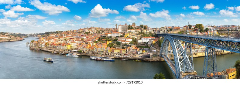 Panoramic aerial view of Dom Luis Bridge in Porto in a beautiful summer day, Portugal