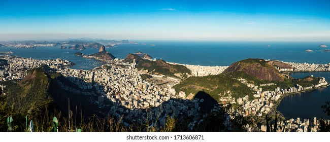 Panoramic aerial view of the entire city of Rio de Janeiro with tourist spots, Sugar Loaf Mountain, Guanabara bay, Copacabana beach and lagoon on the coast of Brazil