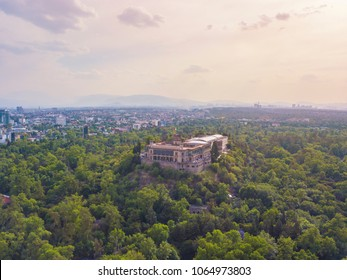 Panoramic aerial view of the famous and majestic Chapultepec Castle surrounded by erotic vegetation
