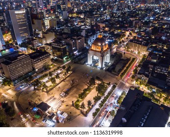 Panoramic aerial view of the famous monument to the revolution at night illuminated with the lights of the city