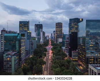 Panoramic aerial view of the famous Reforma avenue in Mexico City with a beautiful cloudy sunset background