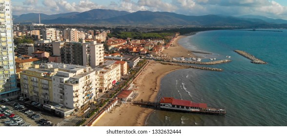 Panoramic aerial view of Follonica, Italy. Coastline of Tuscany with town and ocean.