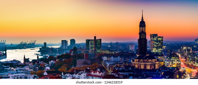 Panoramic aerial view of the harbor, St. Michael's Church (German: St. Michaelis) and downtown Hamburg, Germany.