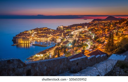 Panoramic aerial view of the historic town of Dubrovnik, one of the most famous tourist destinations in the Mediterranean Sea, in beautiful evening twilight at dusk, Dalmatia, Croatia