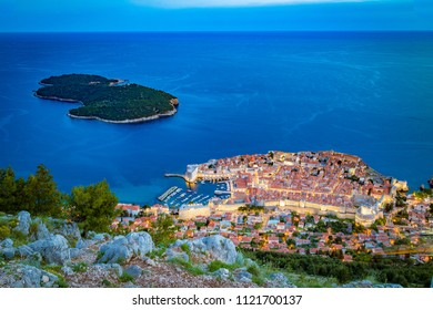 Panoramic aerial view of the historic town of Dubrovnik with Lokrum island in beautiful evening twilight at dusk, Dalmatia, Croatia