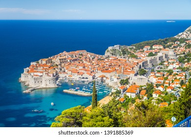 Panoramic aerial view of the historic town of Dubrovnik, one of the most famous tourist destinations in the Mediterranean Sea, from Srd mountain on a beautiful sunny day in summer, Dalmatia, Croatia