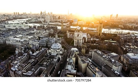 Panoramic Aerial View of Houses of Parliament Big Ben Icon in Central London feat.The London Eye Wheel, River Thames and Iconic Business Buildings Skyscrapers with Beautiful Sunrise