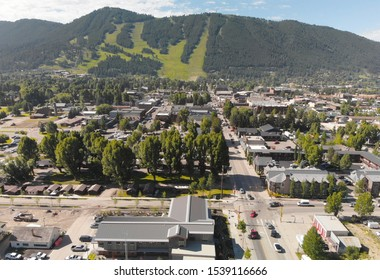 Panoramic aerial view of Jackson Hole homes and beautiful mountains on a summer morning, Wyoming.