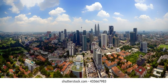A panoramic aerial view of the Kuala Lumpur city during daylight