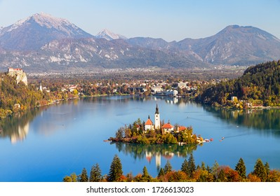 Panoramic aerial view of Lake Bled with Church of the Assumption of Maria and Julian Alps in autumn, Slovenia, Europe.