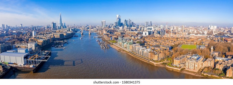 Panoramic aerial view of London, UK. Beautiful skyscrapers, London city district, Tower Bridge and river Thames