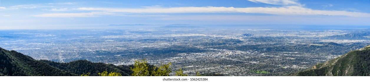 Panoramic aerial view of Los Angeles and the metropolitan area surrounding it; Pacific Ocean coastline in the background, south California