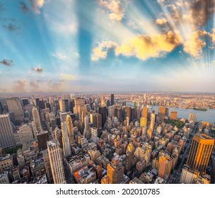 Panoramic aerial view of Manhattan at dusk.